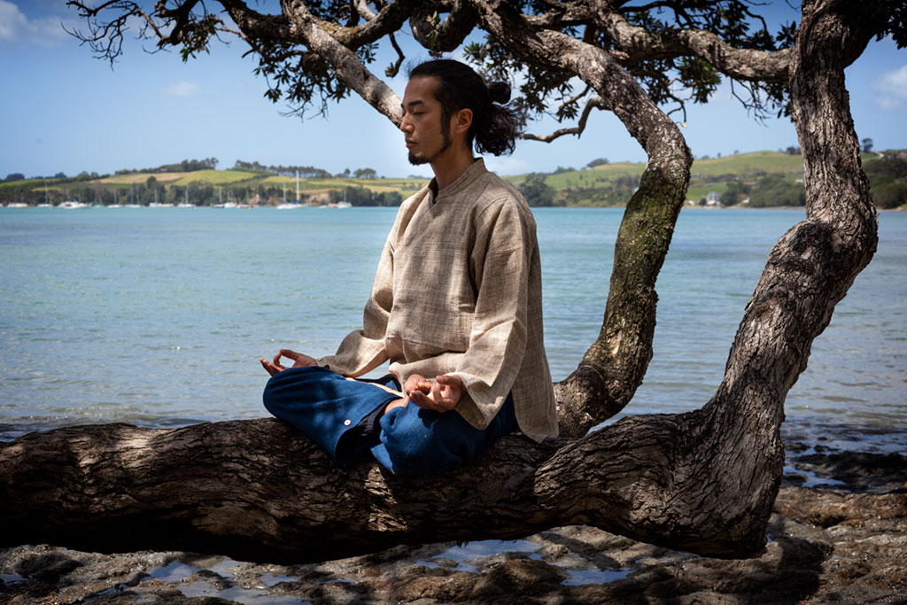 Taka meditating on a tree.